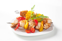 Grilled meat and vegetable on skewers and ketchup