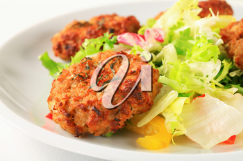 Fried vegetable burgers with green salad