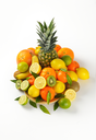 plate of fresh tropical fruit on white background