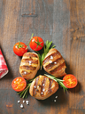 grilled pork medallions on wooden cutting board