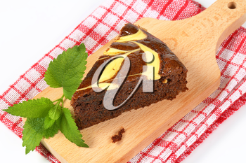 Slice of chocolate spice cake with cheese