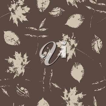 Seamless pattern with paint prints of leaves on a brown  background