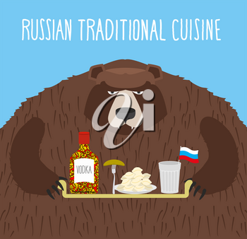 National Folk Food in Russia. Russian national cuisine. Bear with tray of traditional meal: vodka, dumplings and cucumber.