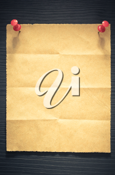 folded note paper on wooden background