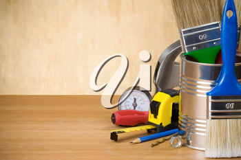 set of construction tools and instruments on wood background