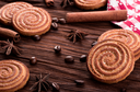 Cookies on a table with spices and coffee beans