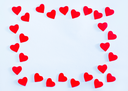 red hearts from paper on the white table
