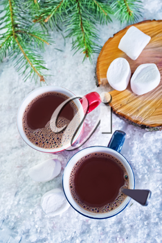 cocoa drink in red cup and on white snow
