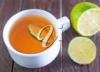fresh tea with lemon in white cup