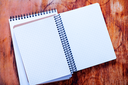 empty notebook on the wooden background