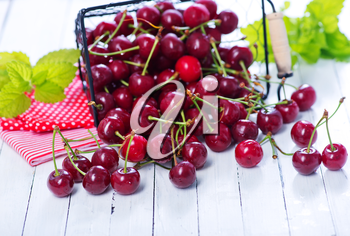 fresh cherry in metal basket and on a table