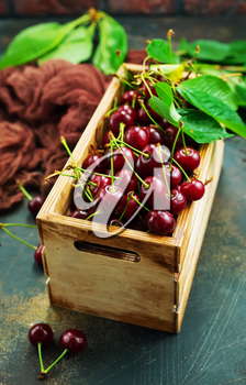 Fresh cherry, Cherries with leaves in wooden box