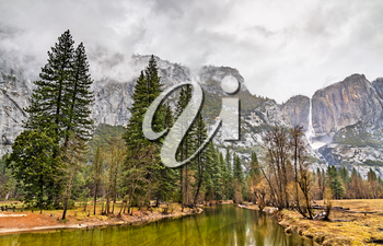 The Merced river and Upper Yosemite Fall in Yosemite National Park - California, United States