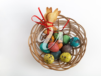 Easter basket with cookies in the form of rabbits and quail eggs. Top view.