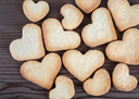 Heart shaped cookies on wooden background. Top view.