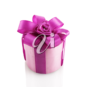 Purple festive gift box with ribbon and bow on a white background. Isolated with clipping path.