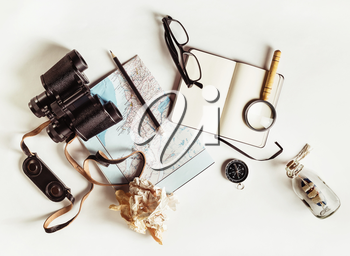 Travel still life. Outfit and accessories of traveler. Vintage toned image. Top view. Flat lay.
