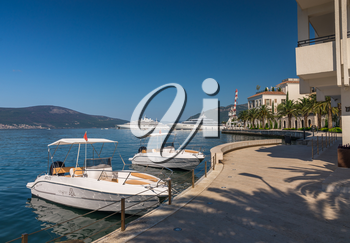 Tivat, Montenegro - 07.11.2018. Embankment of Tivat city, Montenegro, in a sunny summer day. The beginning of the cruise on the Bay of Kotor.