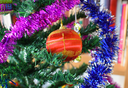 Glass beads for decorating the Christmas tree. Tinsel, balls and toys decorated fir.
