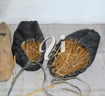 Leather sandals stuffed with hay to maintain the shape.