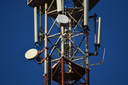 Satellite antennas and repeaters on the tower. Telecommunications.