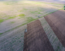 Top view of the tractor that plows the field. disking the soil. Soil cultivation after harvest.