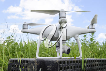 Quadrocopters on a plastic box in the grass. Preparation quadrocopter to fly.