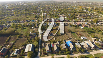 Top view of the village. The village of Poltavskaya. Top view of the village. One can see the roofs of the houses and gardens. Village bird's-eye view.