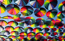Multi-colored umbrellas in the sky.Umbrellas rainbow colors