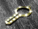 Beautiful glow Golden key lies on the black-and-white wooden background.