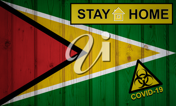 Flag of the Guyana in original proportions. Quarantine and isolation - Stay at home. flag with biohazard symbol and inscription COVID-19.