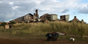 Panoramic view of old deserted sugar mill being overgrown by nature near Koloa, Kauai in Hawaii