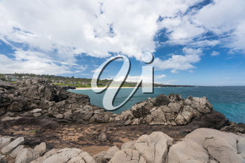Coastline and housing development on golf course from Makaluapuna Point near Kapalua, Maui, HI, USA