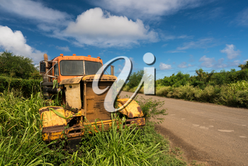 Old and abandoned rusting truck used for sugar cane to Koloa sugar mill on Hawaiian island of Kauai