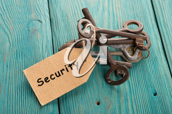 home security concept - old keys with tag