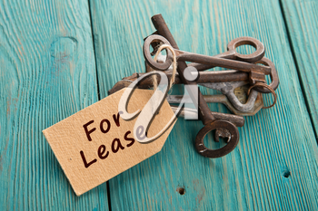 real estate lease concept - old key with tag