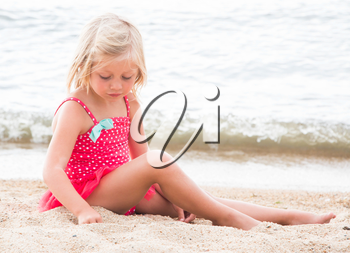 Cute Little Girl Sunbathing on the Beach