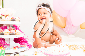 Young Baby Girl Celebrating Her First Birthday With Cake
