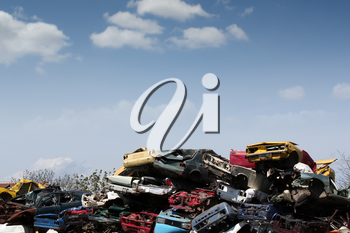 junk yard with old cars and wreck