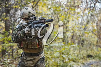 United states Marine Corps special operations command Marine Special Operator also known as Marsoc raider wearing camouflage uniforms in the forest