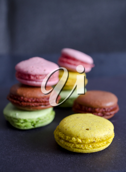 Colorful macaroons variety closeup on dark background. A french sweet delicacy. Dessert.