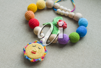 Necklace made from knitted beads for the baby sitting in a sling. Knitted beads. Sling necklace.