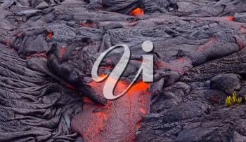 Current lava on the surface of the earth. Liquid lava.