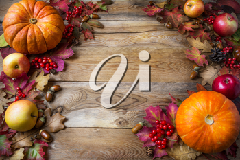 Thanksgiving or fall concept with pumpkins and apples, copy space . Thanksgiving background with seasonal vegetables and fruits. Fall background.