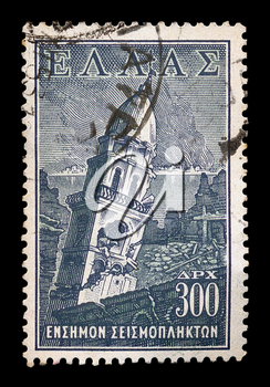GREECE - CIRCA 1953. Vintage social welfare stamp for the earthquake victims of 12th August 1953 which caused widespread damage throughout the islands of Kefalonia and Zakynthos, with burning city and church steeple ruins illustration, circa 1953.